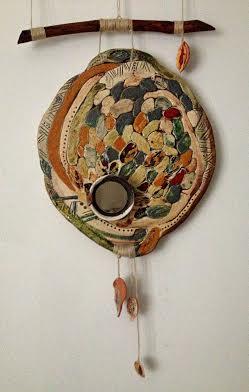 Декоративне панно «У дзеркалі осені», 2011. Техніка: ручна ліпка. Матеріали: шамотна маса, ангоб, глазурі. Додаткові матеріали: дерево, скло, шнур.